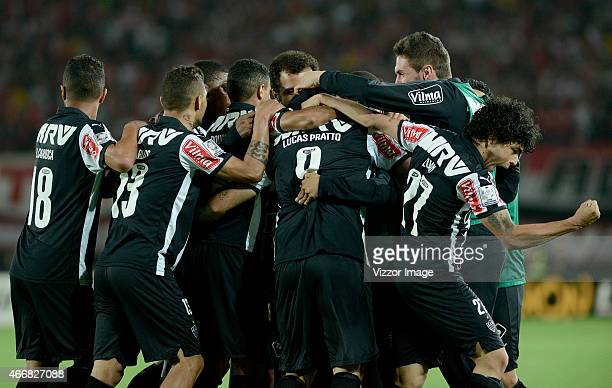 Lucas Pratto of Atletico Mineiro celebrates with teammates after scoring the opening goal during a match between Independiente Santa Fe and Atletico...