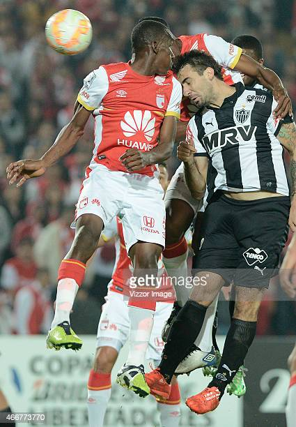 Lucas Pratto of Atletico Mineiro heads the ball to score the opening goal during a match between Independiente Santa Fe and Atletico Mineiro as part...