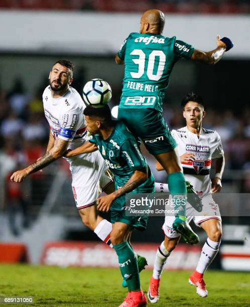 Lucas Pratto of Sao Paulo and Felipe Melo of Palmeiras ficht for tha ball during the match between Sao Paulo and Palmeiras for the Brasileirao Series...