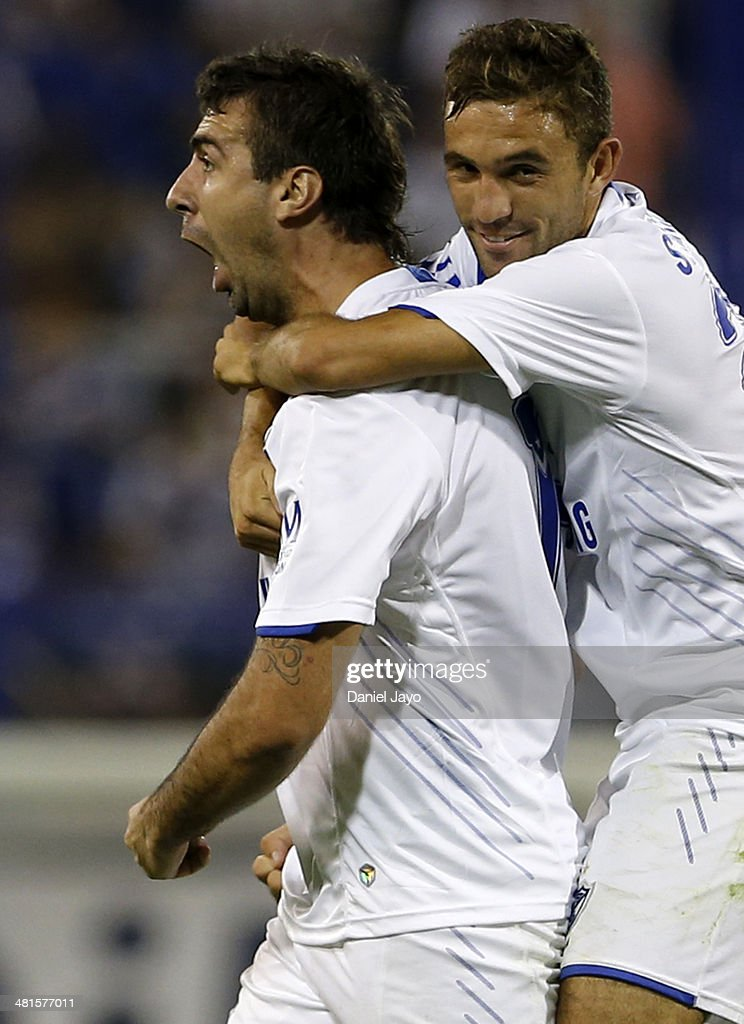 Lucas Pratto of Velez Sarsfield and Agustin Allione celebrate after scoring the third goal against Gimnasia y Esgrima La Plata during a match between Velez Sarsfield and Gimnasia y Esgrima La Plata as part of 10th round of Torneo Final 2014 at Jose Amalfitani Stadium on March 29, 2014 in Buenos Aires, Argentina.
