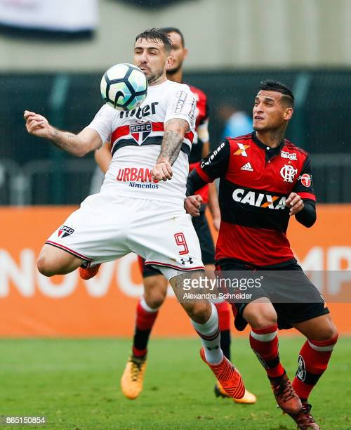 Lucas Prattto of Sao Paulo and and Miguel Trauco of Flamengo in action during the match between Sao Paulo and Flamengo for the Brasileirao Series A...