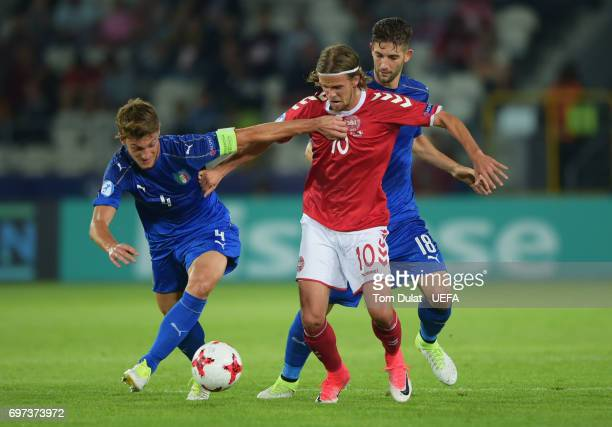 Lucas Qvistorff Andersen of Denmark and Daniele Rugani of Italy compete for the ball during the UEFA European Under21 Championship Group C match...