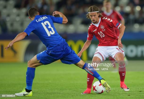 Lucas Qvistorff Andersen of Denmark attempts to get past Mattia Caldara of Italy during the UEFA European Under21 Championship Group C match between...