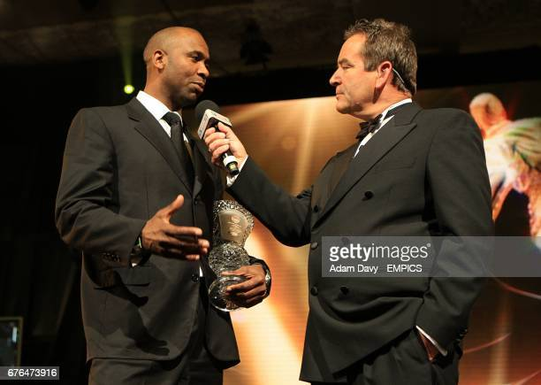 Lucas Radebe with his Special Merit award speaks to Jeff Stelling at the PFA Player of the Year Awards 2010 at the Grosvenor House Hotel London