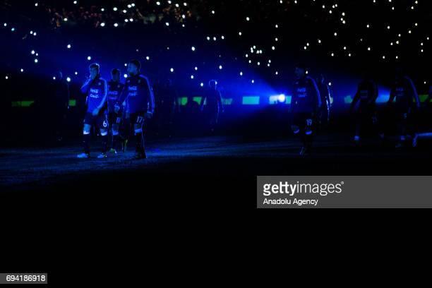 Lucas Rodrigo Biglia Nicolas Otamendi and Angel Di Maria of Argentina walk off the field after their warm up as blue lights illuminate the ground...