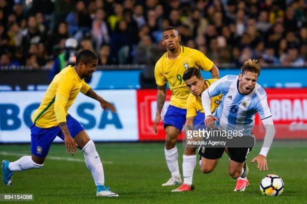 Lucas Rodrigo Biglia of Argentina gets tackled during a friendly football international between Argentina and Brazil at the Melbourne Cricket Ground...