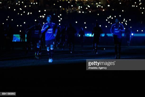 Lucas Rodrigo Biglia of Argentina walks off the field after their warm up as blue light illuminates the ground before a friendly football...