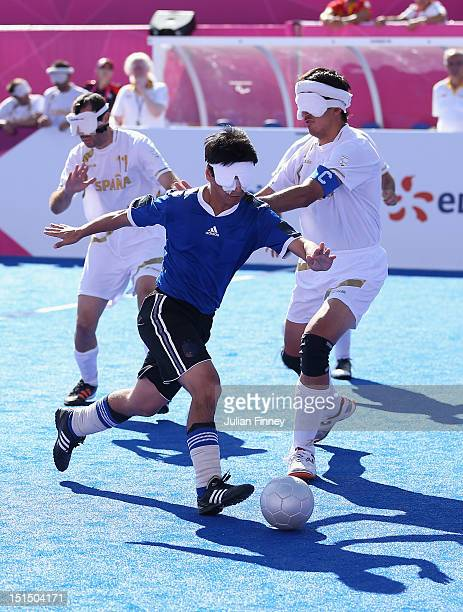 Lucas Rodriguez of Argentina goes past Adolfo Acosta Rodriguez of Spain in the bronze medal match during the 5 aside Football on day 10 of the London...