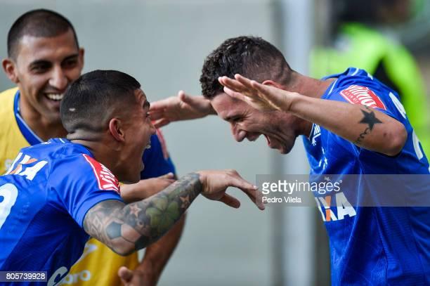 Lucas Romero and Thiago Neves of Cruzeiro celebrates a scored goal against Atletico MG during a match between Atletico MG and Cruzeiro as part of...