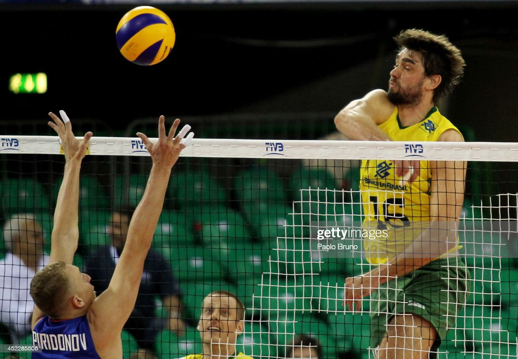 Lucas Saatkamp of Brazil spikes the ball during the FIVB World League Final Six match between Russia and Brazil at Mandela Forum on July 17, 2014 in Florence, Italy.