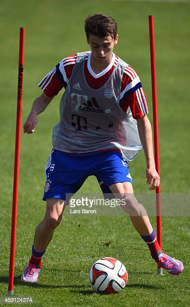 Lucas Scholl runs with the ball during a Bayern Muenchen training session at day five of the Audi Summer Tour USA 2014 at Portland University on...