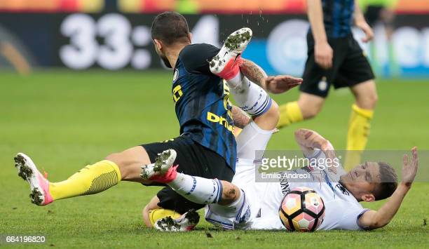Lucas Sebastian Torreira of UC Sampdoria competes for the ball with Ever Banega of FC Internazionale Milano during the Serie A match between FC...