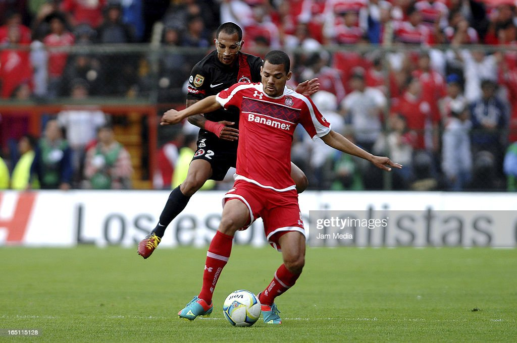 Lucas Silva (R) of Toluca struggles for the ball with Edgar Castillo (L) of Tijuana during a match Clausura 2013 Liga MX at Nemesio Diez Stadium on march 30, 2012 in Toluca, Mexico.