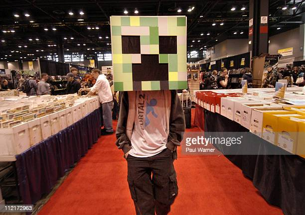 Lucas Simes of Chicago dresses as a 'Creeper' from the video game Minecraft on day three of the Chicago Comic Entertainment Expo at McCormick Place...