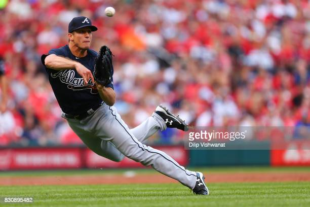 Lucas Sims of the Atlanta Braves throws to first base against the St Louis Cardinals in the first inning at Busch Stadium on August 12 2017 in St...