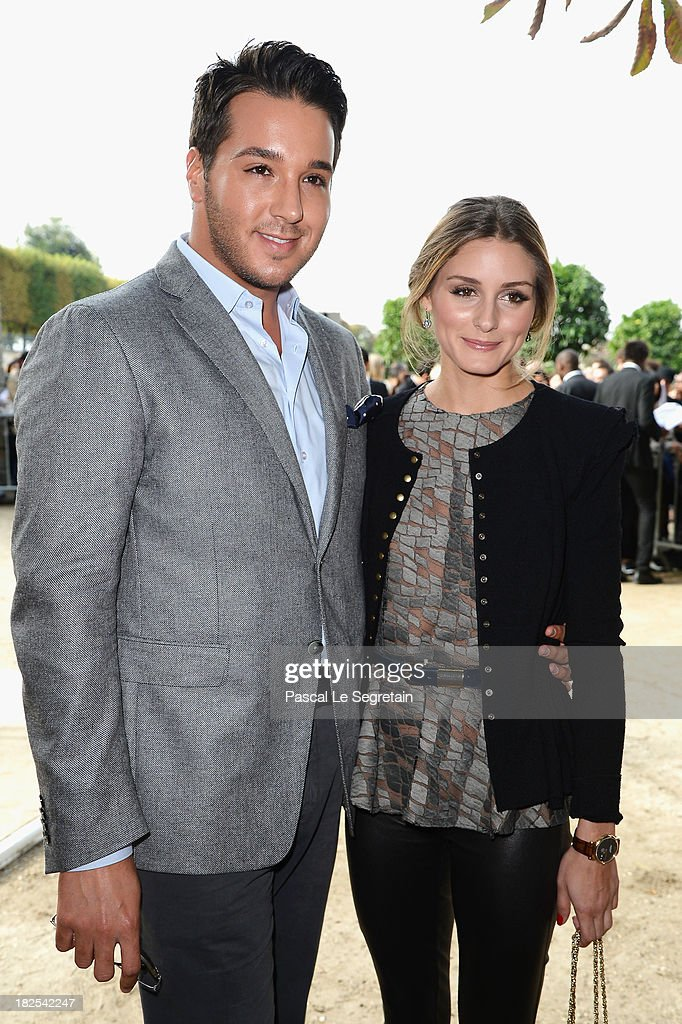 Lucas Somoza and Olivia Palermo attend the Elie Saab show as part of the Paris Fashion Week Womenswear Spring/Summer 2014 at Espace Ephemere Tuileries on September 30, 2013 in Paris, France.