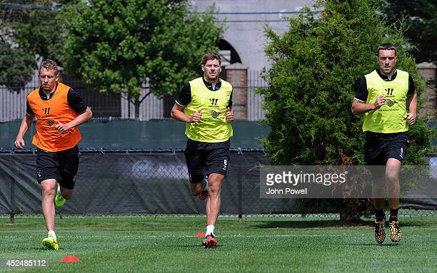 Lucas Steven Gerrard and Rickie Lambert of Liverpool in action during a training session at Harvard University on July 21 2014 in Cambridge...