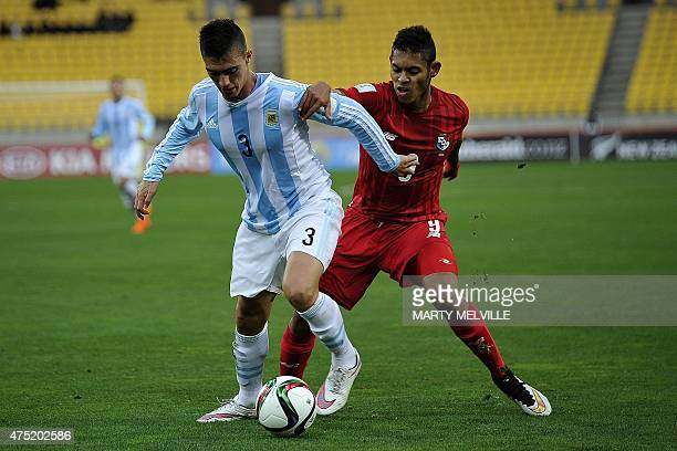 Lucas Suarez of Argentina dribbles the ball with Ismael Diaz of Panama in defense during FIFA's Under20 World Cup's football match between Argentina...