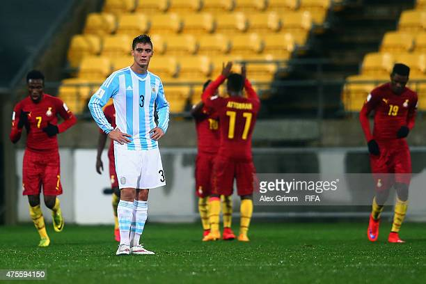 Lucas Suarez of Argentina reacts as players of Ghana celebrates their team's first goal during the FIFA U20 World Cup New Zealand 2015 Group B match...