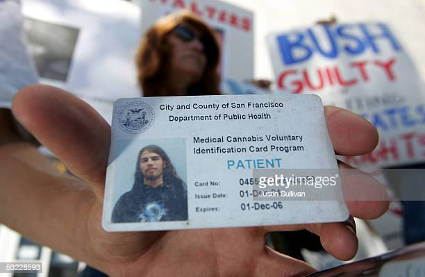 Lucas Thayer holds his medical marijuana club card during a demonstration in front of the San Francisco Hall of Justice July 12 2005 in San Francisco...