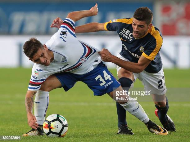 Lucas Torreira of UC Sampdoria competes for the ball with Mattia Valoti of Hellas Verona during the Serie A match between Hellas Verona FC and UC...