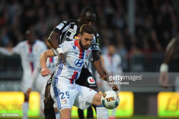 Lucas Tousart of Lyon and Cheickh Ndoye of Angers during the French Ligue 1 match between Angers and Lyon on April 28 2017 in Angers France