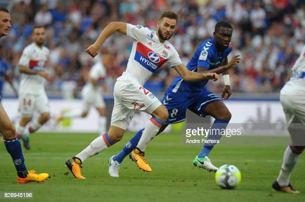 Lucas Tousart of Lyon and Jean Aholou of Strasbourg during the Ligue 1 match between Olympique Lyonnais and Strasbourg at Parc Olympique on August 5...