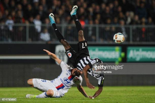 Lucas Tousart of Lyon and Karl Toko Ekambi of Angers during the French Ligue 1 match between Angers and Lyon on April 28 2017 in Angers France