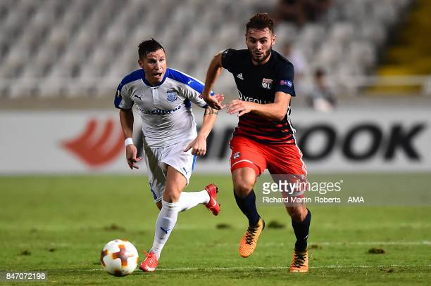 Lucas Tousart of Olympique Lyonnais competes with Esteban Sachetti of Apollon Limassol during the UEFA Europa League group E match between Apollon...