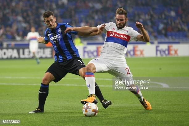 Lucas Tousart of Olympique Lyonnais Lyon challenges for the ball with of Atalanta during the UEFA Europa League group E match between Olympique...