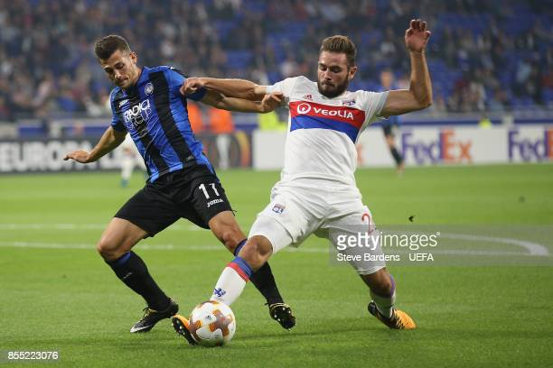 Lucas Tousart of Olympique Lyonnais Lyon challenges for the ball with Remo Freuler of Atalanta during the UEFA Europa League group E match between...
