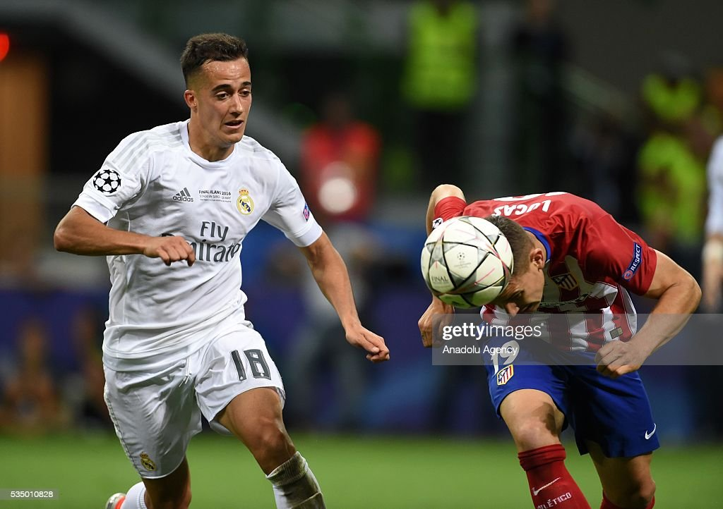 Lucas Vasquez of Real Madrid (L) and Lucas Hernandez of Atletico Madrid (R) vie for the ball during the UEFA Champions League Final between Real Madrid CF and Atletico Madrid at the Giuseppe Meazza Stadium in Milan, Italy on May 28, 2016.