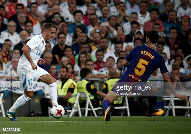 Lucas Vazque of Real Madrid in action against Sergio Busquets of Barcelona during the Spanish Super Cup return match between Real Madrid and...