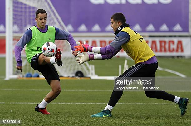 Lucas Vazquez and Ruben Yanez of Real Madrid in action during a training session at Valdebebas training ground on November 29 2016 in Madrid Spain
