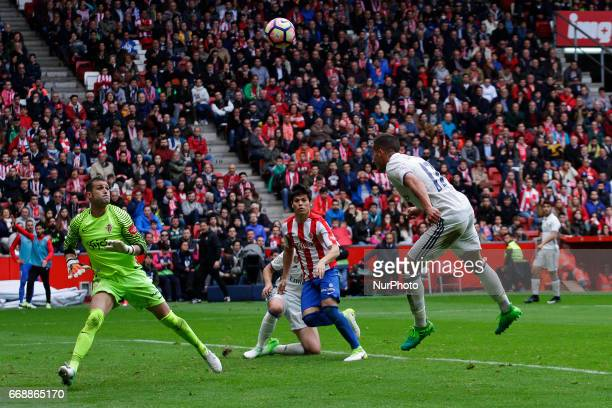 Lucas Vazquez forward of Real Madrid jumps to head the ball during the La Liga Santander match between Sporting de Gijon and Real Madrid at Molinon...