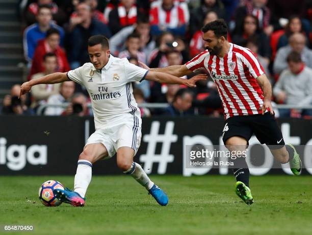 Lucas Vazquez of Real Madrid and Laporte of Athletic Club comoete for the ball during the La Liga match between Athletic Club and Real Madrid at San...