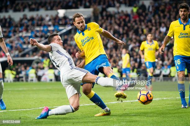 Lucas Vazquez of Real Madrid attempts a kick while being defended by Dani Castellano of UD Las Palmas during their La Liga match between Real Madrid...