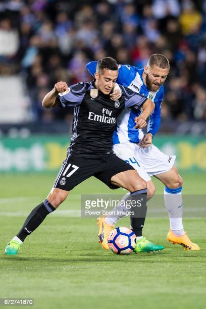 Lucas Vazquez of Real Madrid battles for the ball with David Timor Copovi of Deportivo Leganes during their La Liga match between Deportivo Leganes...