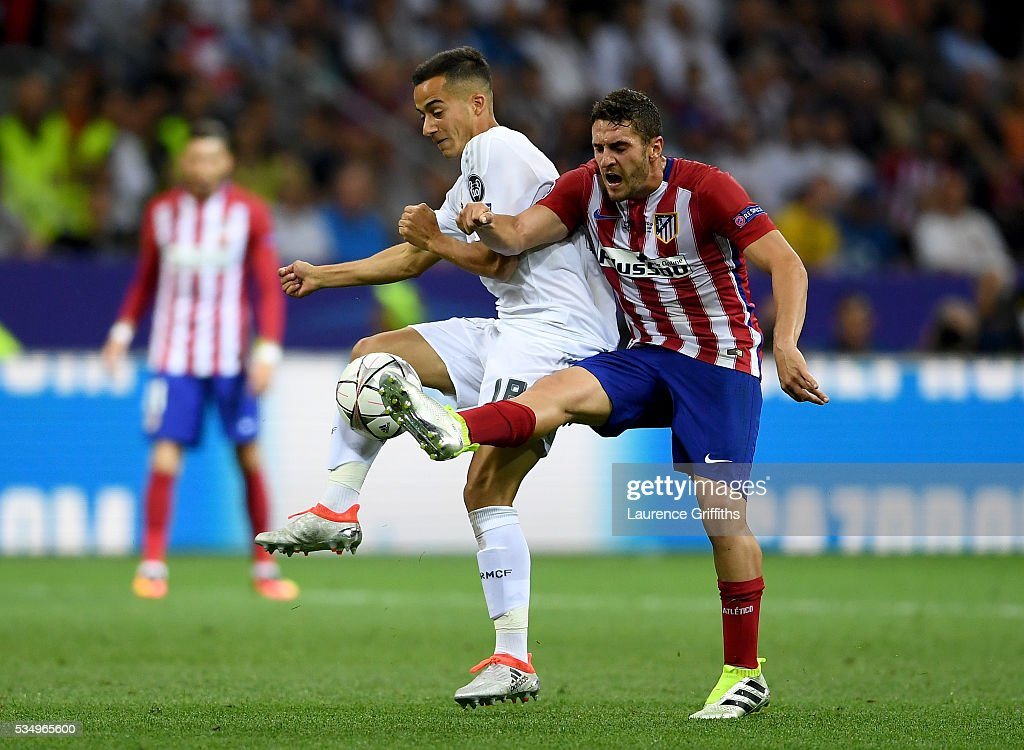 Lucas Vazquez of Real Madrid battles for the ball with <a gi-track='captionPersonalityLinkClicked' href=/galleries/search?phrase=Koke+-+Midfielder+born+1992&family=editorial&specificpeople=11132098 ng-click='$event.stopPropagation()'>Koke</a> of Atletico Madrid during the UEFA Champions League Final match between Real Madrid and Club Atletico de Madrid at Stadio Giuseppe Meazza on May 28, 2016 in Milan, Italy.