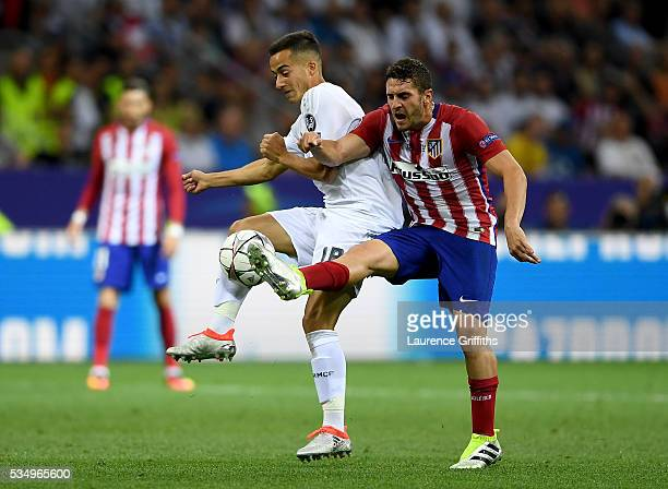 Lucas Vazquez of Real Madrid battles for the ball with Koke of Atletico Madrid during the UEFA Champions League Final match between Real Madrid and...