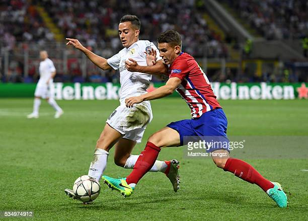 Lucas Vazquez of Real Madrid battles for the ball with Lucas Hernandez of Atletico Madrid during the UEFA Champions League Final match between Real...