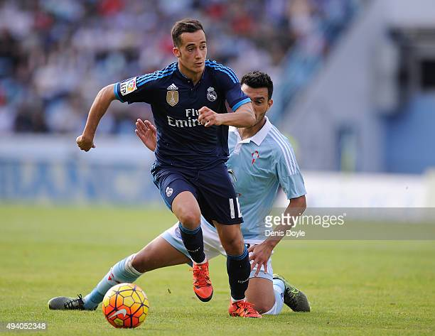 Lucas Vazquez of Real Madrid beats Gustavo Cabral of Celta Vigo during the La Liga match between Celta Vigo and Real Madrid at Estadio Balaidos on...