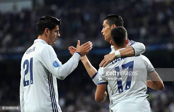 Lucas Vazquez of Real Madrid celebrates scoring his team's fourth goal with his team mate Alvaro Morata and Cristiano Ronaldo during the UEFA...