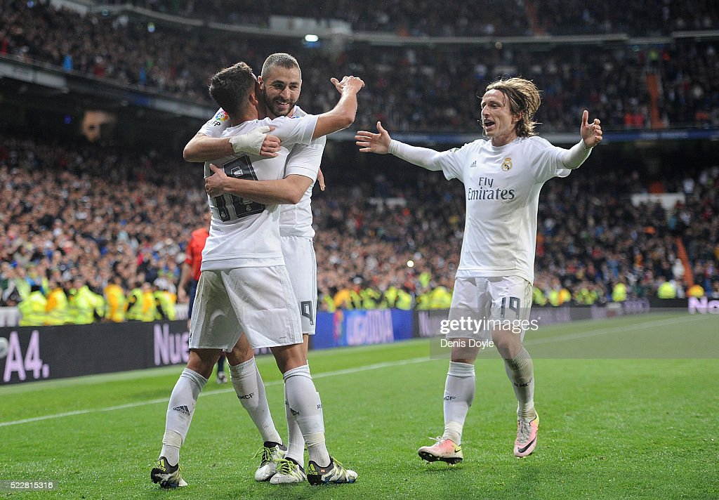 Lucas Vazquez of Real Madrid celebrates with Karim Benzema and Luka Modric after scoring Real's 2nd goal during the La Liga match between Real Madrid and Villarreal at Estadio Santiago Bernabeu on April 20, 2016 in Madrid, Spain.