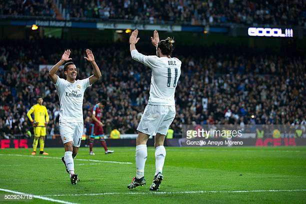 Lucas Vazquez of Real Madrid CF celebrates scoring their third goal with teammate Gareth Bale during the La Liga match between Real Madrid CF and...