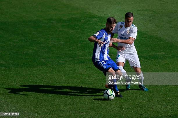 Lucas Vazquez of Real Madrid CF competes for the ball with Alvaro Medran of Deportivo Alaves during the La Liga match between Deportivo Alaves and...
