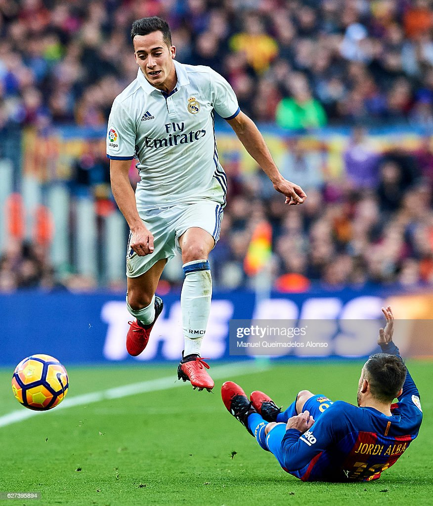 Lucas Vazquez of Real Madrid CF competes for the ball with Jordi Alba of FC Barcelona during La Liga match between FC Barcelona and Real Madrid CF at...