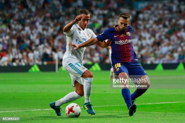 Lucas Vazquez of Real Madrid CF competes for the ball with Jordi Alba of FC Barcelona during the Supercopa de Espana Final 2nd Leg match between Real...