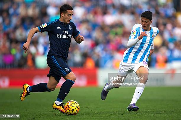 Lucas Vazquez of Real Madrid CF competes for the ball with Pablo Fornals of Malaga CF during the La Liga match between Malaga CF and Real Madrid CF...