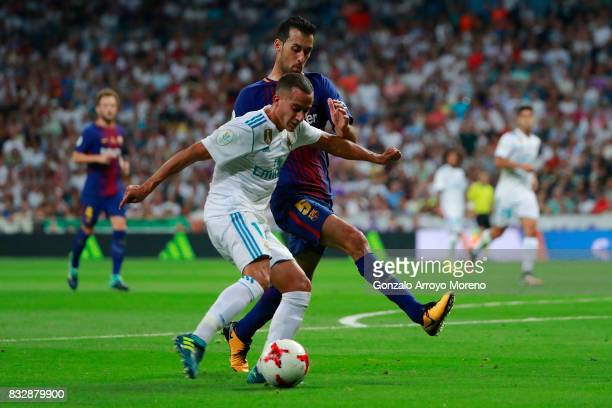 Lucas Vazquez of Real Madrid CF competes for the ball with Sergio Busquets Burgos of FC Barcelona during the Supercopa de Espana Final 2nd Leg match...
